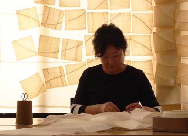 Miran Lee in her studio, image courtesy of the artist.